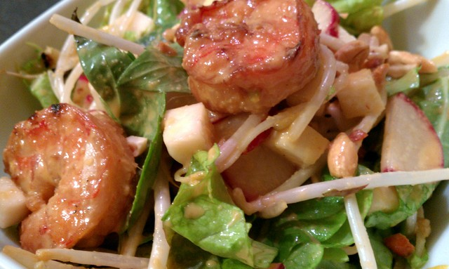 dressed asian salad with grilled shrimp and ginger dressing