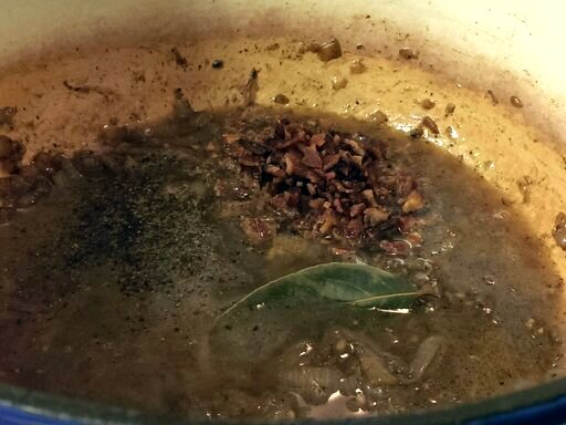 add broth and cider to bacon onion jam