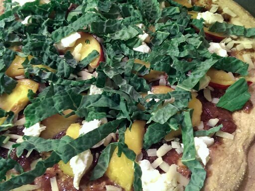 kale topping peaches and onion jam