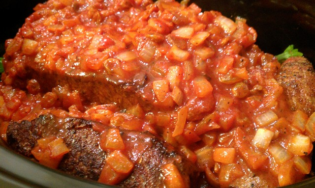 brisket topped with tomato sauce and raisins